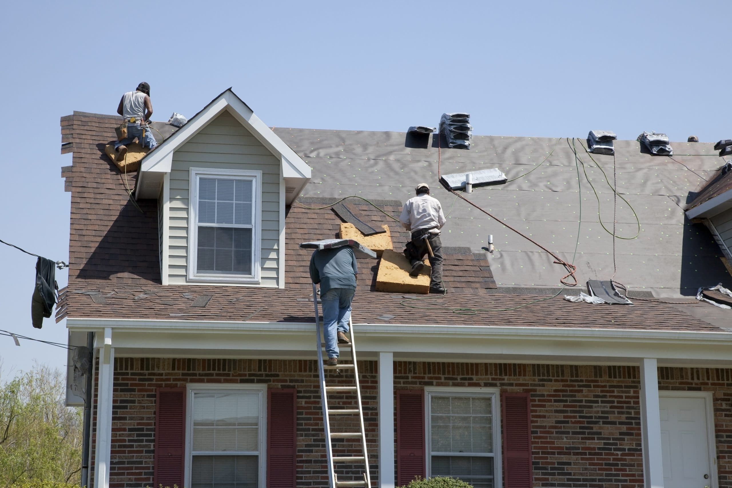Roofers replacing damaged shingles in macon